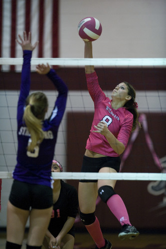 Warren County's Arianna Smoot goes up for a kill over the outstretched arms of Strasburg's Madison Foltz during a Thursday night volleyball match in Front Royal. Rich Cooley/Daily