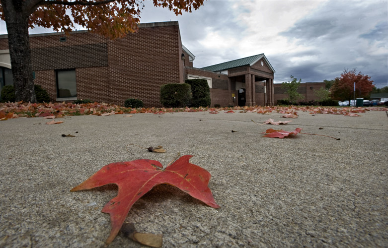 A fallen maple leaf rests on the sidewalk Friday outside the Shenandoah County Administration Offices on North Main Street in Woodstock. Rich Cooley/Daily