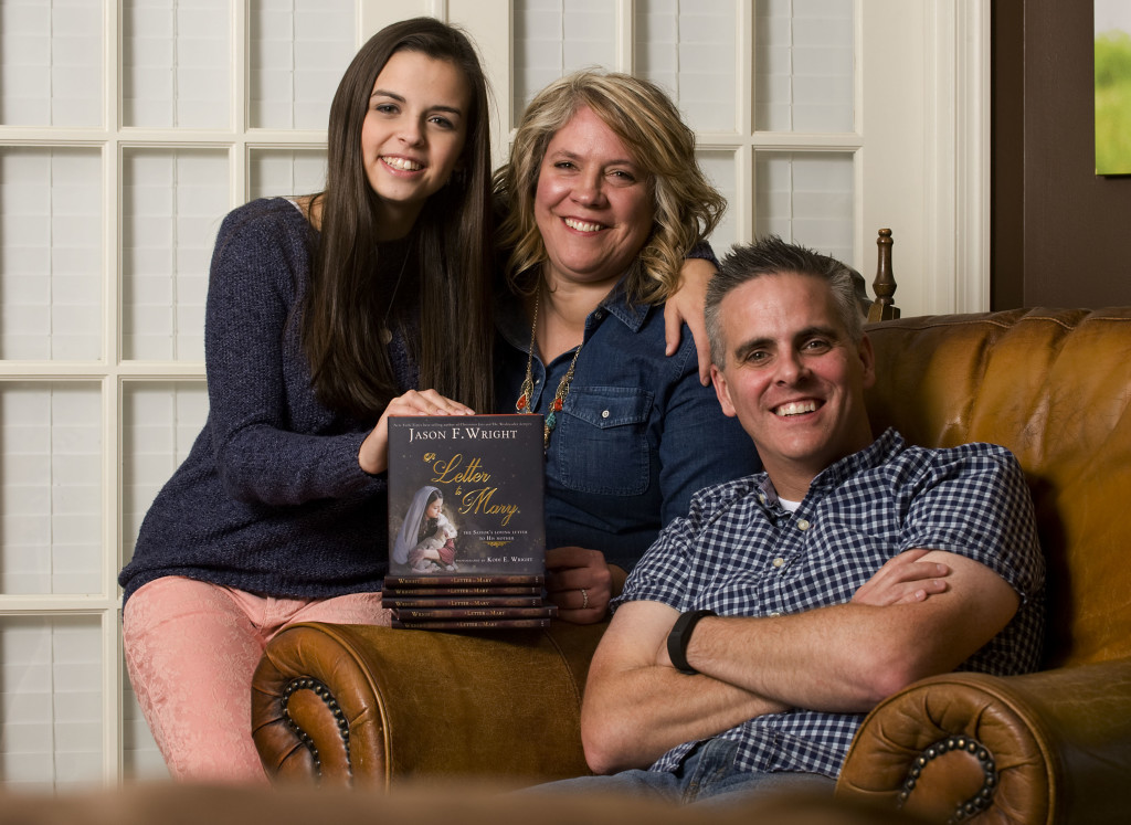 "Jason Wright just published a family project, ""A Letter to Mary,"" with his wife Kodi, center, providing the photography, and his daughter Jadi, 17, left, portraying Mary. Rich Cooley/Daily"
