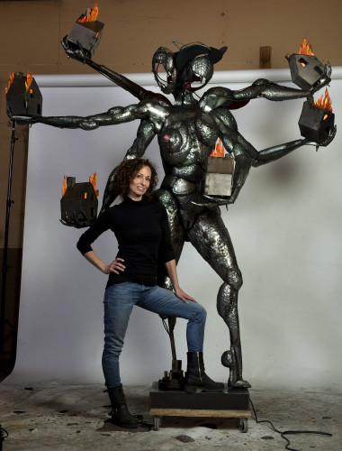 "Front Royal artist Melissa Ichiuji poses by her sculpture titled ""Goddess of the Burning House."" The sculpture is on display at the Katzen Arts Center at American University in Washington, D.C.   Rich Cooley/Daily"