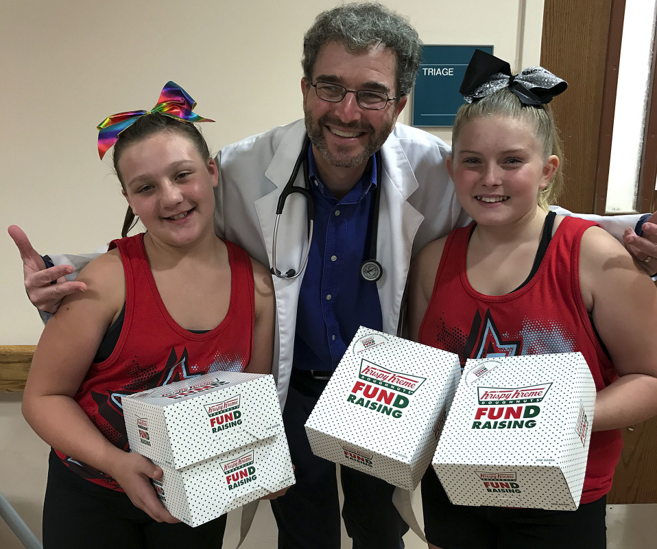 Arianna Masella and Mikalah Phillips, members of the Front Royal All-Star Legacy Team Sabotage, donated doughnuts to Dr. James W. Freilich in the Emergency Room at Warren Memorial Hospital recently.   They also donated doughnuts to  members of Company 1 of the Warren County Fire Academy, members of the Warren County Sheriff's Office and  Front Royal police. Courtesy photo