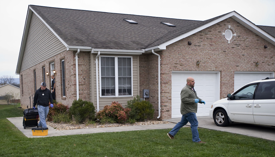Shenandoah County Sheriff's Office investigator Aaron Springer, left, and Woodstock Police Department investigator Derek Good, walk outside a Lora Drive residence in Woodstock on Thursday morning where an alleged breaking and entering occurred.  Rich Cooley/Daily