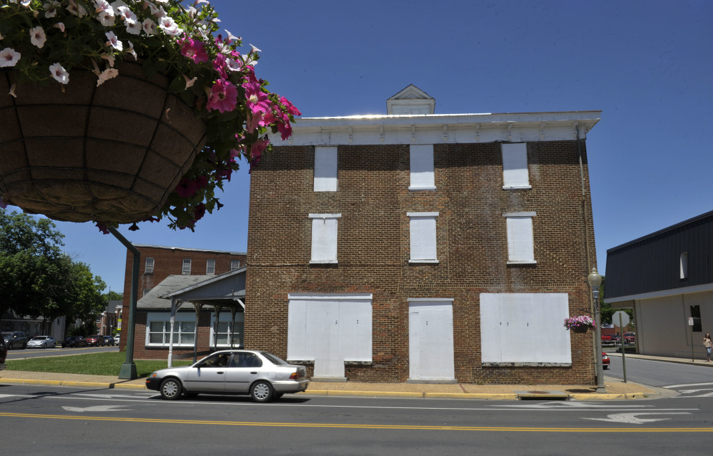 A basket of flowering petunias frames the Afton Inn at the corner of East Main Street and South Royal Avenue in Front Royal. The Front Royal Warren County Economic Development Authority board has adopted a resolution for building's sale.  Rich Cooley/Daily