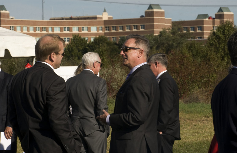 Mark Baker, left, Valley Health vice president of facilities management, chats with Tom Kluge, right, president of Valley Health's West Virginia hospitals, during a groundbreaking ceremony for Valley Health's Surgery Center.   The new center will be located on Botanical Boulevard west of their Winchester campus. Rich Cooley/Daily