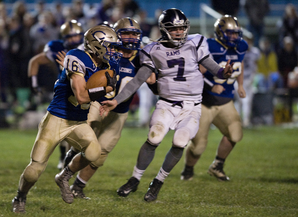 Central's Carston Shockey looks for running room as Strasburg's Ethan Duckworth pursues during second-quarter action Friday night in Woodstock. A win  by Strasburg and Central this Friday would give them a share of the Bull Run District title. Rich Cooley/Daily