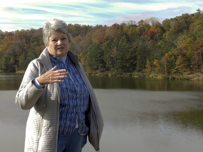 Joan Comanor, Lord Fairfax Soil and Water Conservation District board member, talks about the funding process for the Lake Laura and Bird Haven dams while at Lake Laura. Rachel Mahoney/Daily