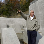 Jim Fagan, chair of the Lord Fairfax Soil and Water Conservation District's dam safety committee, describes to tourgoers the impact of the Bird Haven Dam. Rachel Mahoney/Daily