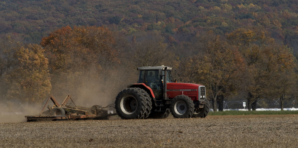 A farmer discs this field off Route 11 and Wissler Road near Meems Bottom on a fall afternoon. Rich Cooley/Daily