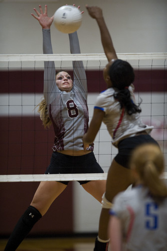 Warren County's Arianna Smoot leaps to block a hit by Riverside's Loren Class during Wednesday night's Conference 28 semifinals in Front Royal. Rich Cooley/Daily