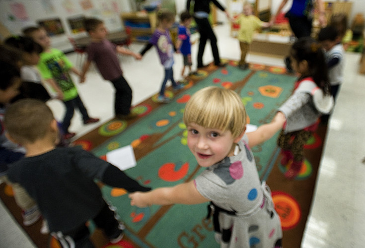Sara Sine, 4, walks around a circle with her classmates in the preschool class at Stonewall Jackson High School in Quicksburg.   Rich Cooley/Daily
