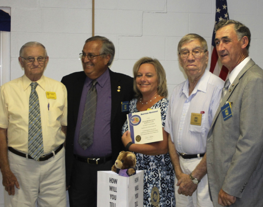 The Maur-Brook-Olive Ruritan Club recently celebrated its 75th anniversary. Shown here, from left, are Roland Bagnell, 50-plus year member; National Director Larry Cassell; Club President Debbie Keller;  and Alvin Vann, a 50-plus year member. Cassell presented Keller with a 75th anniversary certificate from Ruritan National.  Courtesy photo