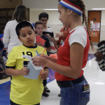 Victor Vasquez, 10, of Woodstock, asks Rosalinda Leon, 14, of Edinburg, how to fill in his ballot after hearing from both parties. Kaley Toy/Daily