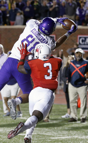 James Madison's Jonathan Kloosterman snags a touchdown pass next to the University of Richmond's Tafon Mainsah in the second half of an NCAA college football game in Richmond on Saturday. JMU won 47-43.  P. Kvein Morley/ Richmond Times-Dispatch via AP