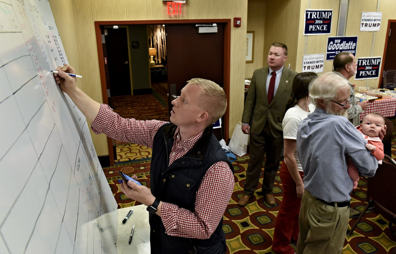 Chad Logan, assistant chairman of the Shenandoah County Republican Party, updates results inside the Hampton Inn in Woodstock on Tuesday night. Rich Cooley/Daily