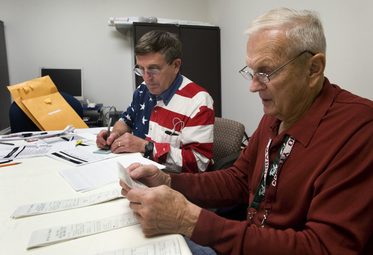 Warren County Electoral Board members Lee Bowen, left, and Bill Hammack canvass ballots from Tuesday's voting inside the Warren County Registrar's office in Front Royal on Wednesday. Rich Cooley/Daily