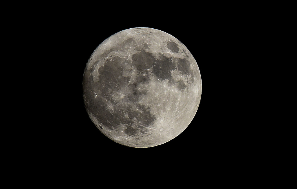The supermoon rises over Strasburg in a photo Sunday evening.  Rich Cooley/Daily