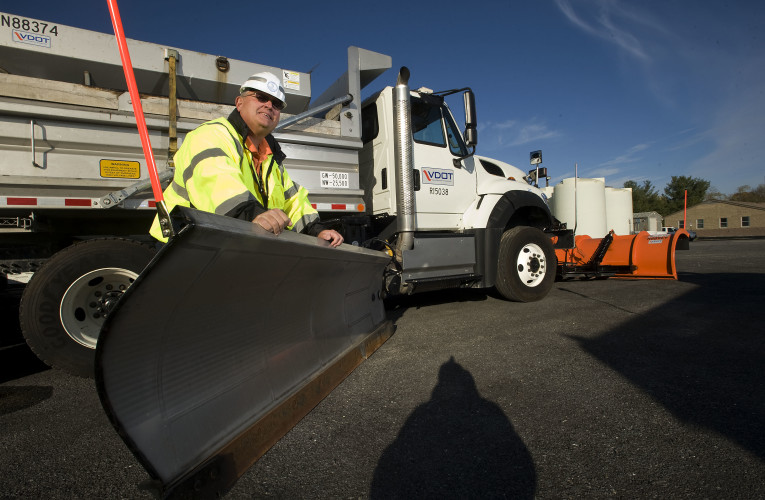 Cliff Balderson, Edinburg VDOT residency administrator, leans on a wing plow truck that will be used to clear area roads this winter. VDOT held its winter weather preparedness news conference Tuesday at the  Stephens City district office. Rich Cooley/Daily