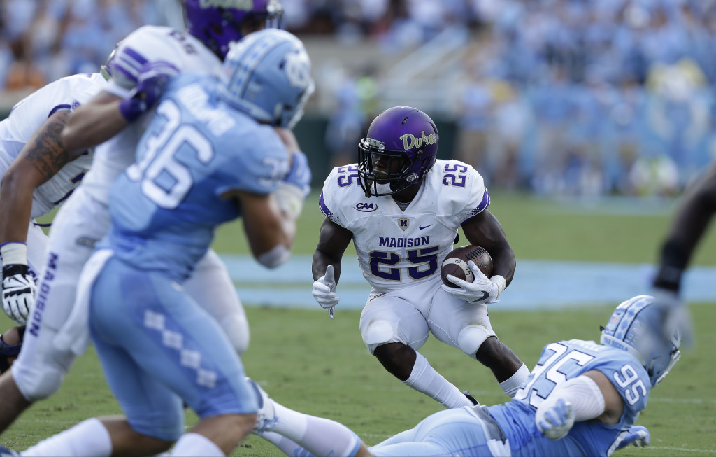 James Madison's Cardon Johnson (25) runs in the first half of a game against North Carolina on Sept. 17. The Dukes have clinched the CAA title and a playoff berth. AP