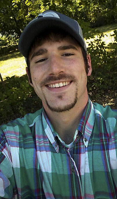 Travis Swinson, who was hit by an SUV while riding his bicycle last Wednesday, is on full life support.  Courtesy Elizabeth Swinson Wade
