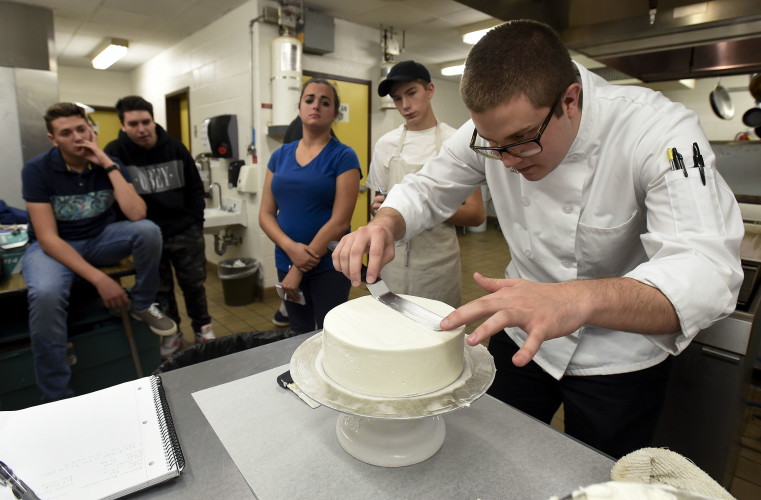 Triplett Tech graduate Cody Fitchett, of Fort Valley, gives a baking demonstration recently to a group of first-year culinary students at the school. Fitchett received an associate's degree in October from the Culinary School of America in Hyde Park, New York. He plans to return to Hyde Park in January to pursue a bachelor's degree.  Rich Cooley/Daily
