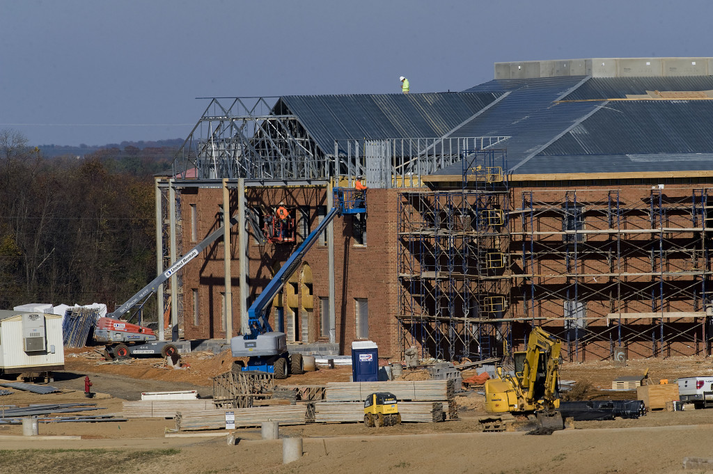 Construction crews work on the facade of the new Warren County Middle School at Leach Run Parkway in Front Royal. Rich Cooley/Daily
