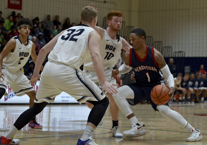 Shenandoah University senior guard Malcolm Clark drives toward the basket during the championship game of the Body Renew Tip-Off Classic against Hood College in Winchester on Saturday.   Courtesy photo by Shenandoah University
