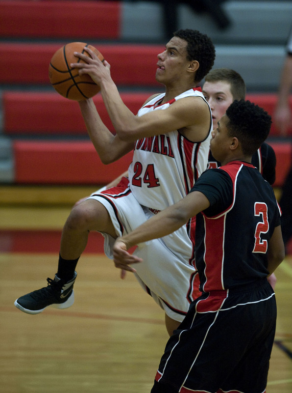 Stonewall's Kaelan Sorrells soars in the lane as East Rockingham's Jaylen McNair looks on during last January's game in Quicksburg.  Rich Cooley/Daily file