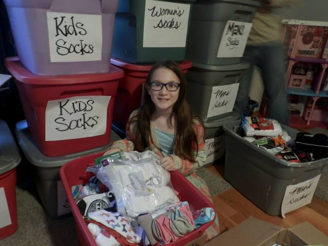 Olivia Vibbert, a seventh grader at Signal Knob Middle School, has started a Cold Feet Warm Hearts campaign for her FCCLA project, in honor of her sister who passed away. She is collecting socks for people in need, especially children.  Kaley Toy/Daily