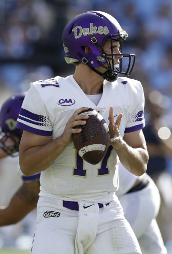 James Madison quarterback Bryan Schor looks to pass in the first half of an NCAA college football game against North Carolina in Chapel Hill, North Carolina, on Sept. 17.   AP Photo/Gerry Broome