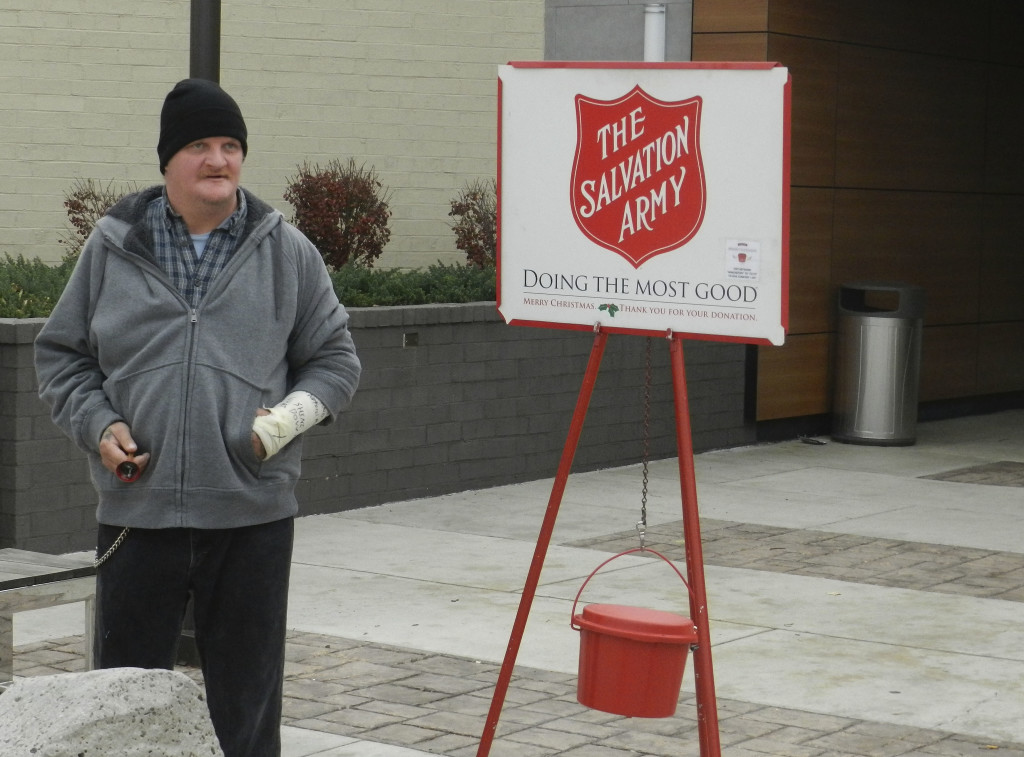Mike Mason, of Winchester, rings a bell on Friday for the Salvation Army in front of Apple Blossom Mall in Winchester. This is his second year helping the charity organization.  Nathan Budryk/Daily