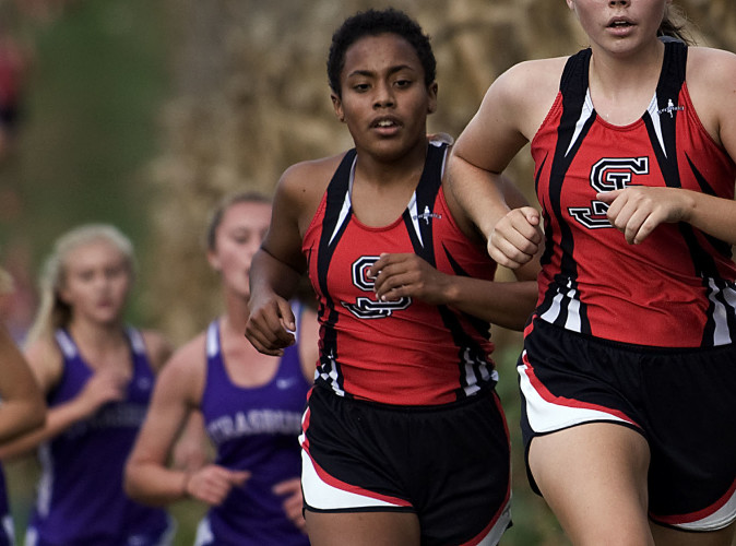 Stonewall's Brandy Webb, left, runs during the Shenandoah County cross country meet earlier this year in Woodstock. Webb, The Northern Virginia Daily's 2016 Girls Cross Country Runner of the Year, finished third in the Group 1A state meet and won the Conference 44 and Region 1A East meets this season. Rich Cooley/Daily