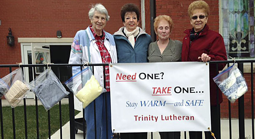 "Trinity Lutheran Church members Charlotte Bailey, Phyllis Wilson, Shirley Harrell and Maxine Rogers  display the congregation's new ""scarf ministry"" outside the church in Stephens City. Courtesy photo"