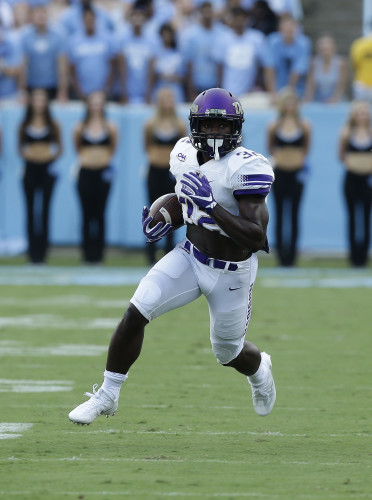 James Madison's Khalid Abdullah (32) runs against North Carolina during their game in Chapel Hill, N.C., on Sept. 17. Abdullah and the Dukes will be hosting New Hampshire in the second round of the Football Championship Subdivision playoffs Saturday. AP file