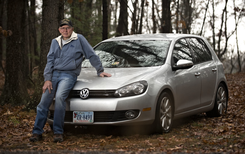 Byron Hukee stands beside his 2011 Volkswagon Golf TDI outside his home in Basye. Hukee is the first in the area to participate in Volkswagen's buyback program, the result of a more than $10 billion settlement after the auto maker was determined to have lied about the carbon dioxide emissions produced by its turbo diesel vehicles.  Rich Cooley/Daily