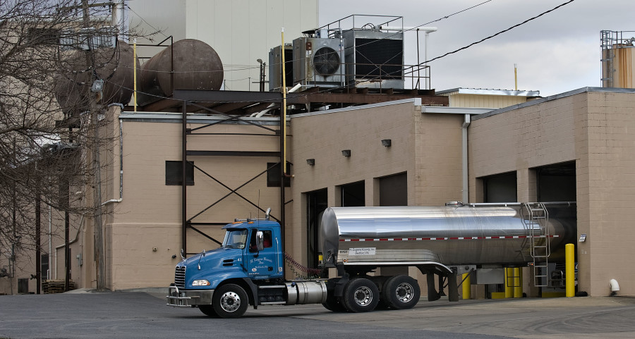 A tractor tanker backs into a bay at  Valley Milk Products along Acton Place in Strasburg on Thursday afternoon. The FDA announced that U.S. Marshals recently seized more than 4 million  pounds of dried milk products from the facility after inspectors found unsuitable sanitary conditions inside the plant last September. Rich Cooley/Daily