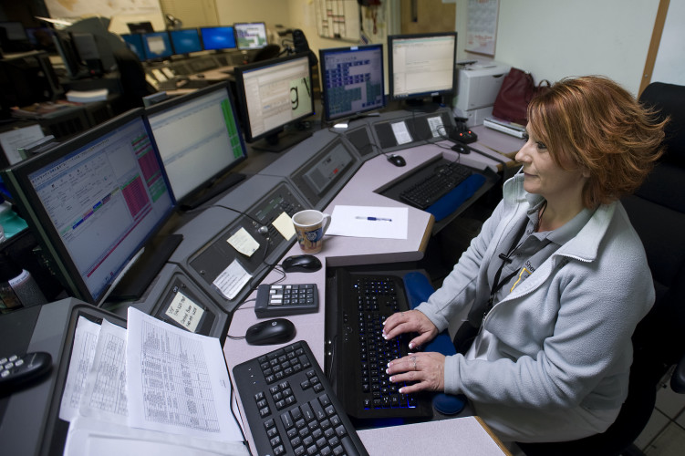 Shenandoah County emergency services dispatcher Jennifer Bowman works at her console inside the county's Communications Center in Woodstock. Bowman, a shift supervisor, recently received the 2016 Governor's EMS Award for Outstanding Contribution to EMS Telecommunications.  Rich Cooley/Daily