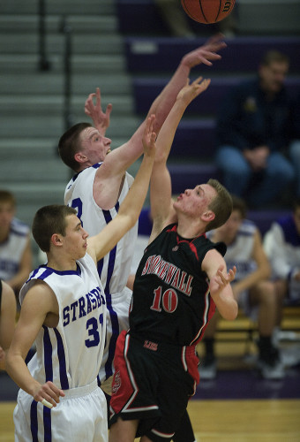 Strasburg's Samuel Hopkins blocks a shot by Stonewall's Brenden Hoover during Friday night's game in Strasburg. Rich Cooley/Daily