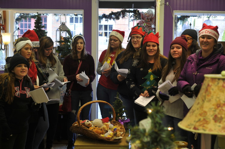 The Strasburg High School Choir dropped in on Simply Devine Candles and Decor in Strasburg on Saturday before the Christmas Parade for a bit of carolling.  Jake Zuckerman/Daily