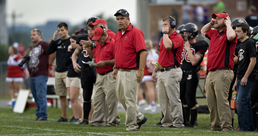 Stonewall football head coach Jay Goode stands on the sidelines during their game against Strasburg in 2015. Goode, citing family issues, stepped down Monday morning as head coach of the Generals.   Rich Cooley/Daily