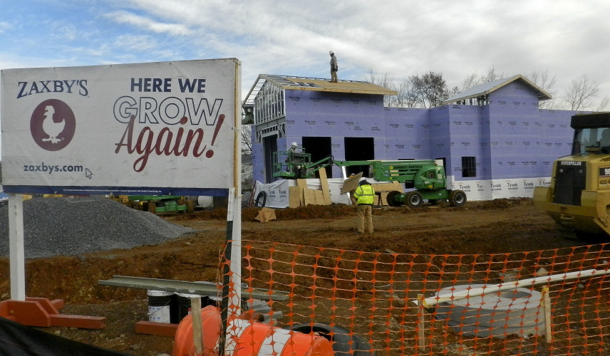 Crews work on the new Zaxby's restaurant at 1810 S. Loudoun St. in Winchester. The restaurant is expected to open in February.  Nathan Budryk/Daily