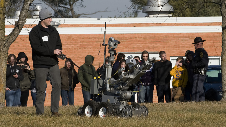 Brian Webster, special agent/bomb technician with the Virginia State Police, maneuvers the department's robot to members of the Criminal Justice class at Triplett Tech in Mount Jackson on Tuesday afternoon. Webster and several of his colleagues gave students demonstrations of their job skills and spoke about what kind of qualities the Virginia State Police look for in applicants.  Rich Cooley/Daily