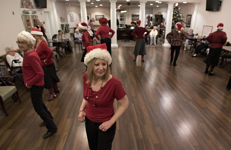 Nancy Stover, the instructor of the John Marshall Dancers, takes the lead in their performance at Hidden Springs Senior Living in Bentonville.  Rich Cooley/Daily