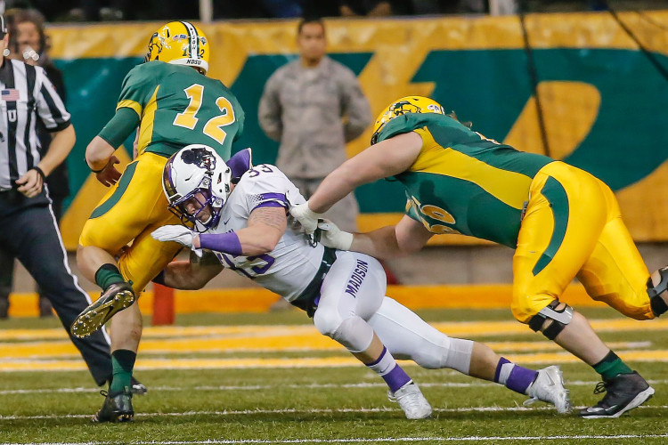 JMU's Gage Steele (33) makes a tackle against North Dakota State on Dec. 16 in Fargo, North Dakota. Steele is one of 13 seniors who have helped lead the Dukes to the FCS championship game. Courtesy photo/JMU Athletics Communications