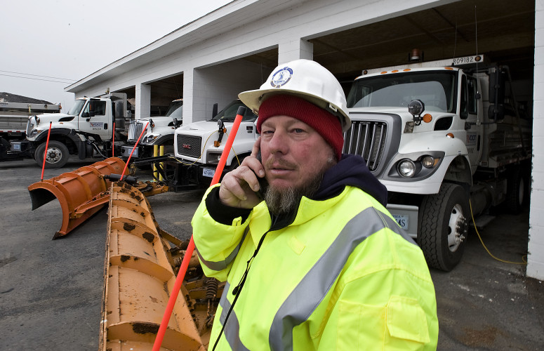 Douglas Estep, a Virginia Department of Transportation operator, talks on his cellphone outside VDOT's Mount Jackson Area Headquarters on Thursday. Estep was working a 12-hour shift that started at noon Thursday in anticipation of snowy weather Thursday night and today.  Rich Cooley/Daily