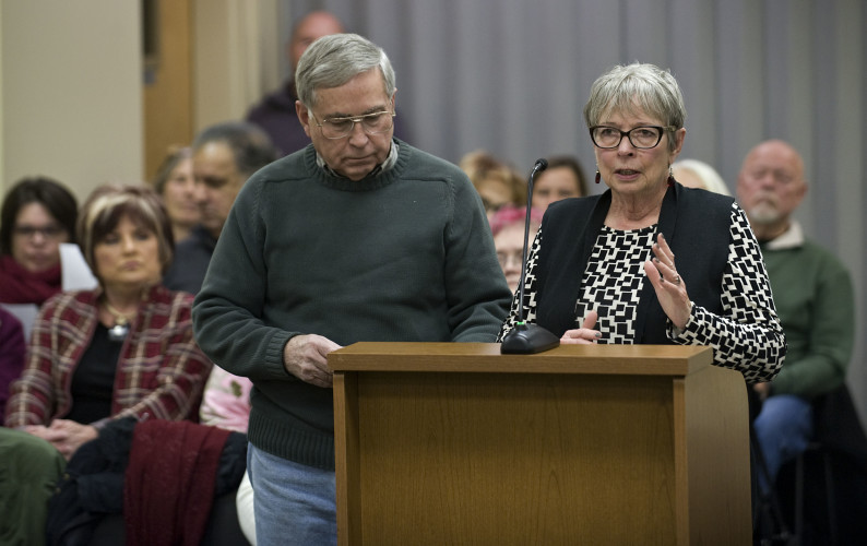 Raymond Willis, left, and Linda Wheeler, right, speak during the Strasburg Town Council meeting Tuesday night. The pair offered $10,000 for the purchase of the Brown property at 128 East King and they wanted to give the building to Lydia's Clothing Basket. Town Council voted to demolish the structure. Rich Cooley/Daily