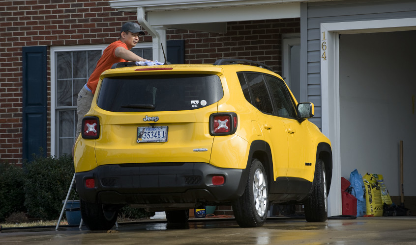 Damond Guangrat, of Front Royal, gives his Jeep a bath outside his home on Kerfoot Avenue during an unseasonably warm winter afternoon.  Temperatures rose to nearly 70 degrees Thursday, but today's high should be in the upper 40s with wintry precipitation expected on Saturday.  Rich Cooley/Daily