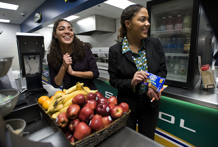 Sarah Chichester, left, and her twin sister Hannah, right, both 18, helped to initiate Skyline High School's Grab and Go breakfast program. The pair came up with the concept to give students an option for breakfast when they were short on time. Rich Cooley/Daily
