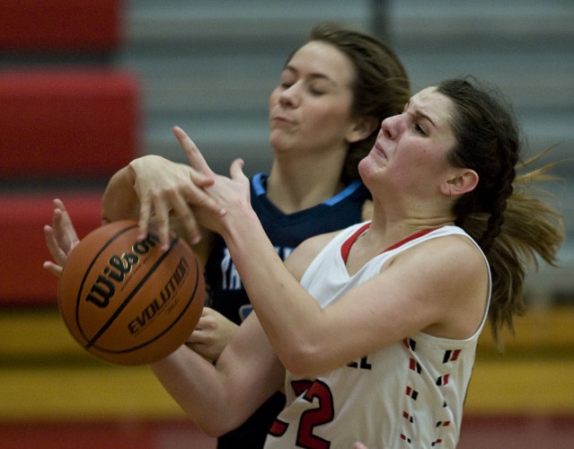 Stonewall's Sara Streett is fouled by Page County's Brooklynn Fridley as she goes to the basket during second quarter basketball action Tuesday night in Quicksburg. Rich Cooley/Daily