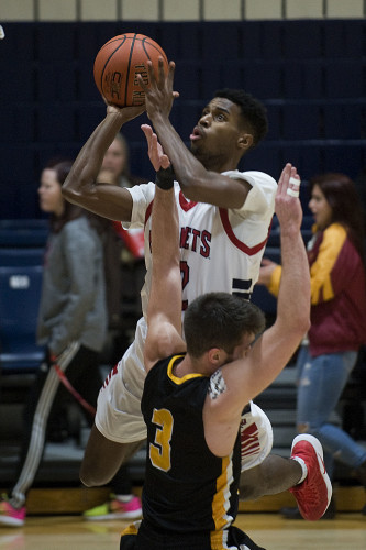 Shenandoah University's Jonah Meredit gets called for an offensive foul as he goes up for a shot into Randolph Macon's Daniel Noe during first half basketball action Wednesday night at Shingleton Gymasium in Winchester.  Rich Cooley/Daily
