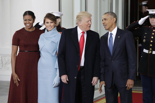 President Barack Obama and first lady Michelle Obama pose with President-elect Donald Trump and his wife Melania at the White House in Washington on Friday. AP Photo/Evan Vucci